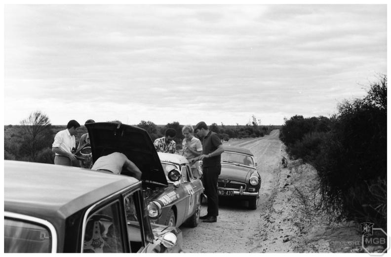 Tom Boyce finishing the radiator change whilst others check over the MGB