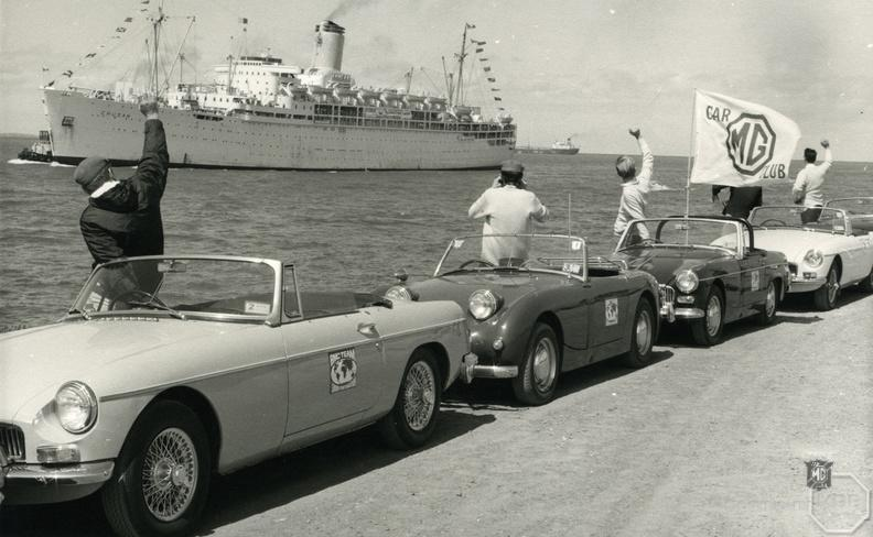 Members of the Western Australian MGCC greet the boat bringing the Marathon crews.